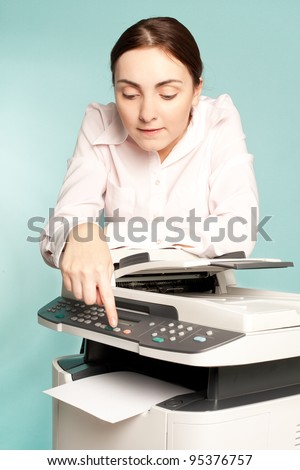 Businesswoman with copier preing on the button - stock photo