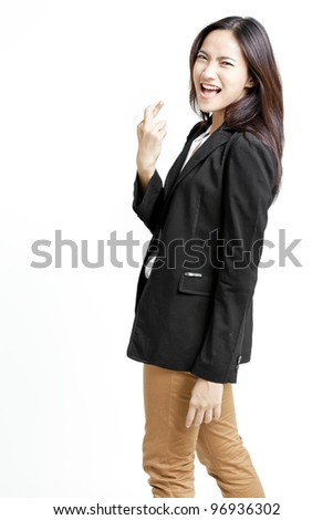 businesswoman with crossed fingers - stock photo