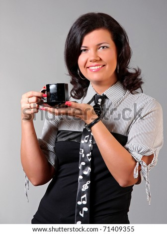 Businesswoman with cup of coffee - stock photo