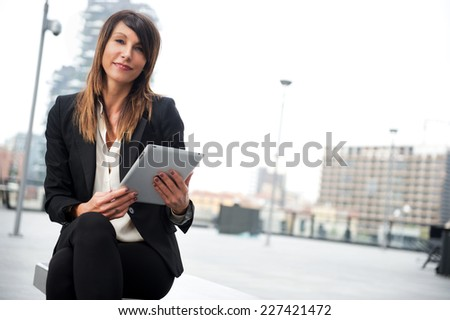 businesswoman with digital tablet - stock photo