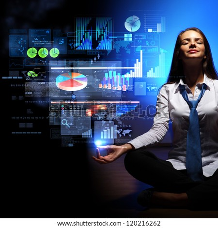 Businesswoman with financial symbols around her on the background - stock photo