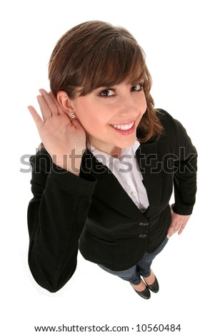 Businesswoman with hand to ear listening - stock photo