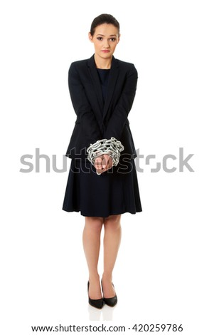Businesswoman with handcuffs. - stock photo