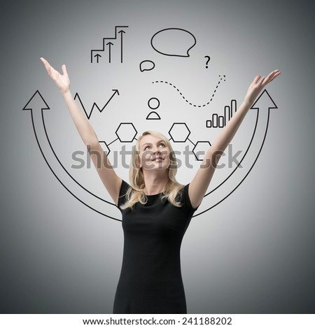 businesswoman with hands raised up, and drawing business strategy - stock photo