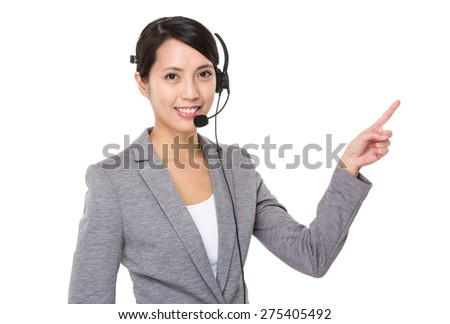 Businesswoman with headset and finger point up - stock photo