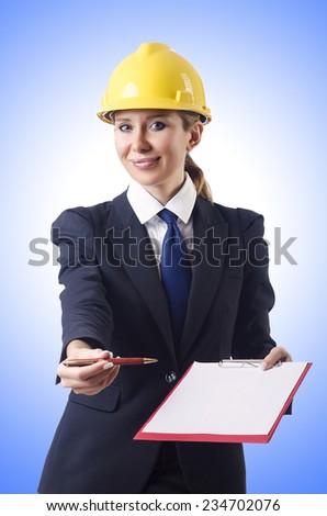 Businesswoman with helmet on white - stock photo
