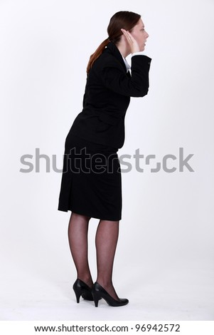 Businesswoman with her hand to her ear - stock photo