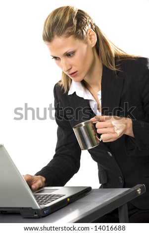 Businesswoman with laptop and cup of coffee isolated over white - stock photo