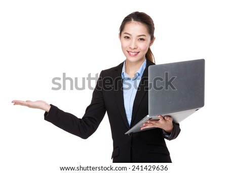 Businesswoman with laptop and open hand