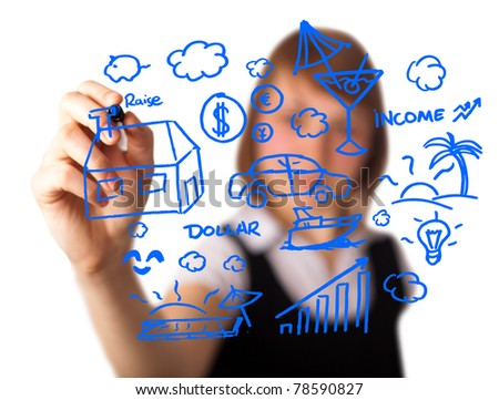 businesswoman with marker writing something on glass writeboard - stock photo