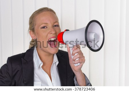 businesswoman with megaphone - stock photo