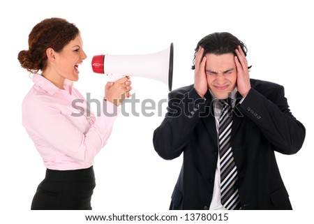 Businesswoman with megaphone yelling at businessman - stock photo