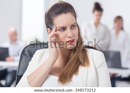 Businesswoman with migraine feeling bad at work - stock photo