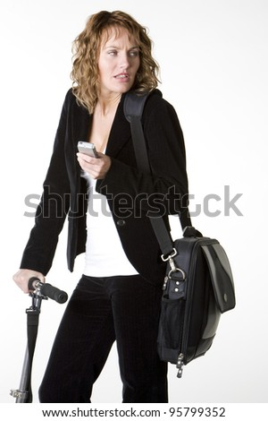 businesswoman with mobile phone and notebook - stock photo