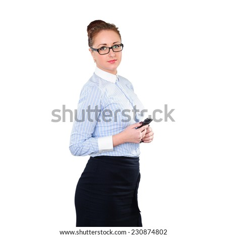 Businesswoman with mobile phone in hand. Young stylish business woman isolated on white. White caucasian redhead female model. - stock photo