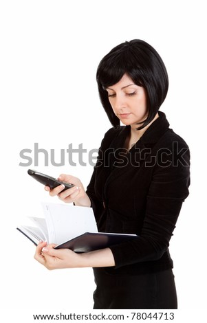 businesswoman with notebook in hand dials the phone on a white background