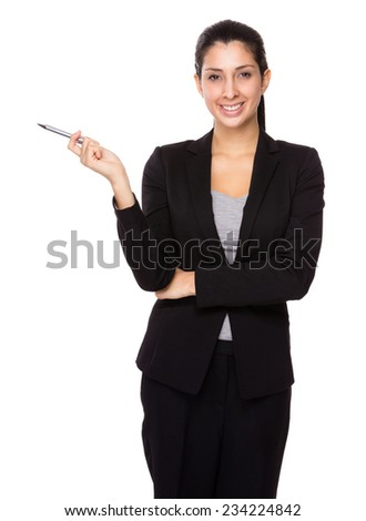 Businesswoman with pen point aside