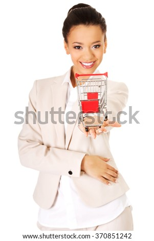 Businesswoman with shopping cart. - stock photo