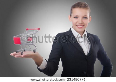 Businesswoman with shopping cart on white - stock photo