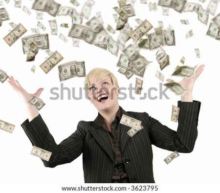 Businesswoman with success, a lot of dollars falling on her - stock photo