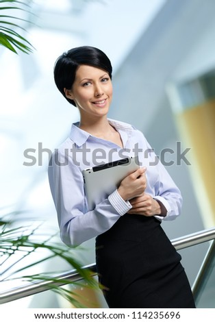 Businesswoman with tablet at the business centre