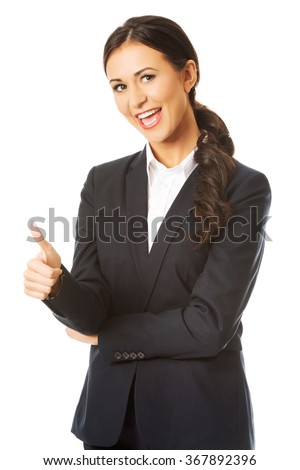 Businesswoman with thumb up gesture - stock photo