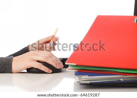 businesswoman - woman hand on mouse pen and computer. Pile of folders with old documents and bills. Isolated on white background - stock photo