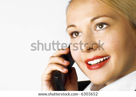 Businesswoman. Woman working in office using mobile phone. Red lips. White background.