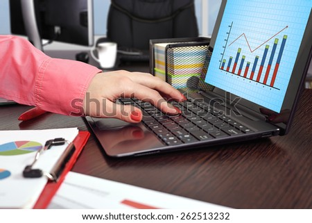 businesswoman working and laptop with forex chart on screen - stock photo