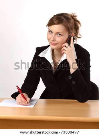 Businesswoman working at a desk, isolated