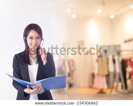 businesswoman working at the office ,call center - stock photo