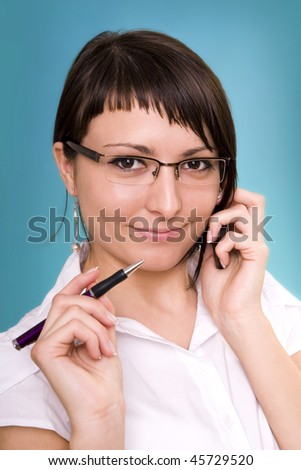 Businesswoman working, holding a cellphone. - stock photo