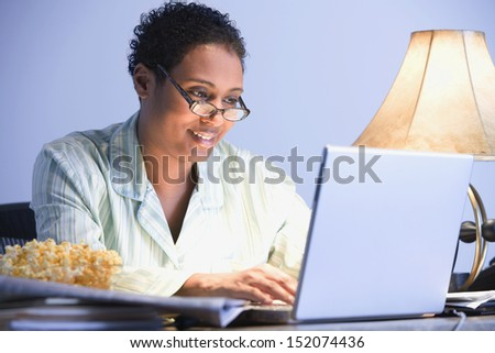 Businesswoman working in pajamas - stock photo