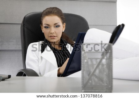 Businesswoman working in the office. Focus on face