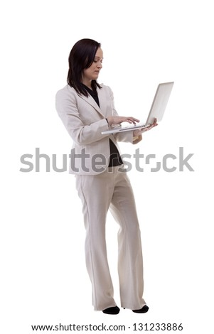 Businesswoman working on a laptop isolated over white full body studio shot - stock photo
