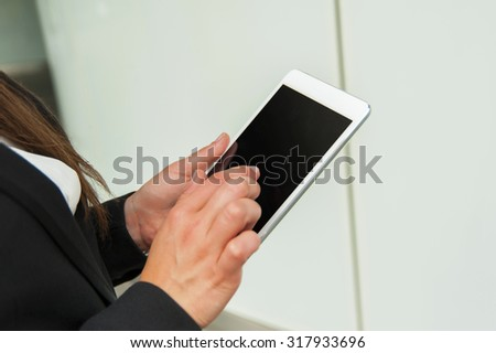 Businesswoman working on tablet closeup of technology. - stock photo
