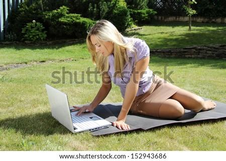 businesswoman working outdoor - stock photo