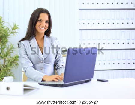businesswoman working with laptop at office - stock photo