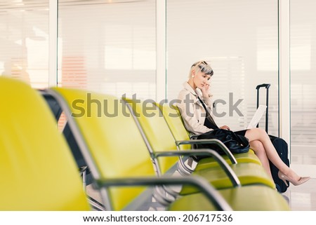Businesswoman working with portable computer at airport, Paris.  - stock photo
