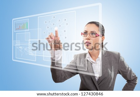 Businesswoman working with touch screen - stock photo
