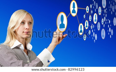businesswoman works with virtual network - stock photo