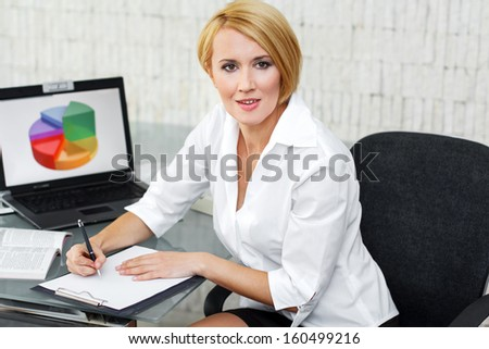 Businesswoman write on white paper, office - stock photo