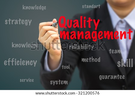 Businesswoman write Quality management relation concept.