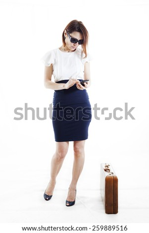 businesswoman writes messages to mobile - stock photo