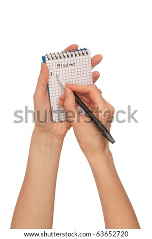 businesswoman writes missions for a business plan - stock photo