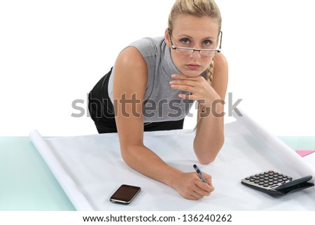 businesswoman writing a  project - stock photo