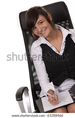 Businesswoman writing documents in the office - stock photo