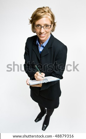 Businesswoman writing on clipboard - stock photo