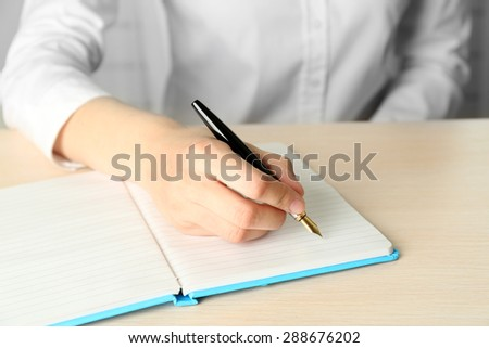 Businesswoman writing on document