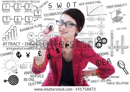 Businesswoman writing on transparent glass with white background - stock photo
